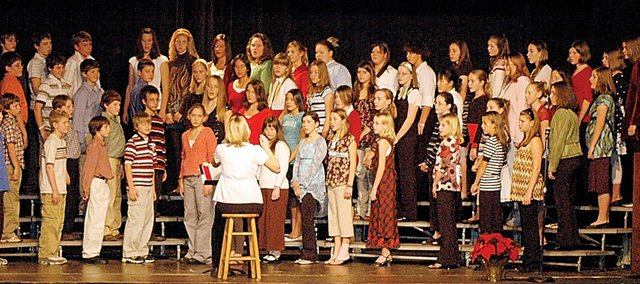 The Baldwin Junior High School choir performs during a Christmas program in December in the current school district auditorium. The stage is said to be too small, as this photo shows, there isn't enough room for audiences, either. The school board will have to decide whether to include almost $3 million on an upcoming bond issue for a new auditorium.