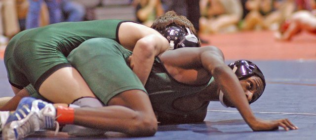 Demitris Hall wrestles in sub-state action. Hall, a freshman, missed a state tournament berth by one victory.