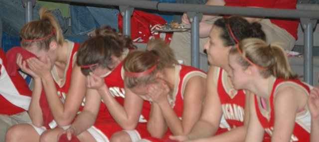 Members of the Tonganoxie High girls basketball team are overcome with emotion in the final seconds of the Chieftains' 67-52, season-ending loss to Holton on Saturday.