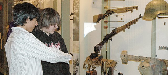 Freddie Ortiz, left, and Skylar Perez, both Lansing High School freshmen, look at a display case full of weaponry at the National World War I Museum in Kansas City. As part of a cross-curriculum project, LHS freshmen took a field to the World War I museum, the Negro Leagues Baseball Museum and the American Jazz Museum.