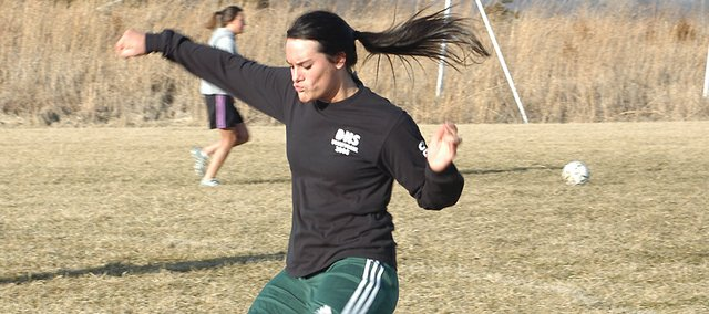 De Soto senior soccer player Julie Bray practices passing the ball to a teammate. The Wildcats open up their season with a March 13 home game against Spring Hill.