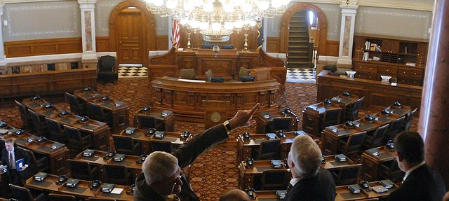 Kansas Speaker of the House Melvin Neufeld, pointing, talks about the House of Representatives chamber during a tour in the west wing of the newly renovated Kansas State Capitol in Topeka.