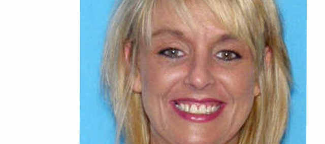 The Olathe Police Department has identified Tammy K. Cochran as the woman whose badly burned body was discovered Wednesday in the East Bottoms.