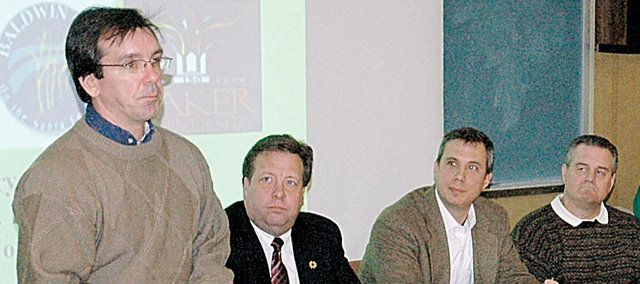 The Federal Election Commission recently released statistics showing Baldwin City residents contribute more money than similar sized towns for politicians like Tony Brown, standing, and State Rep. Tom Holland, seated to the left of Brown.