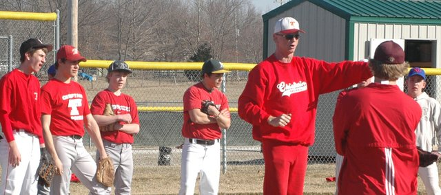The Tonganoxie High baseball team, at its first outdoor practice Monday, gets instructions from coach Phil Loomis at the Leavenworth County Fairgrounds.