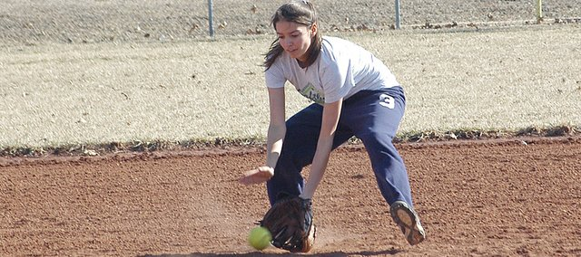 Junior Bailey Scott fields a groundball Tuesday at practice. Eudora opens its softball season March 27 with a home game against Gardner Edgerton.