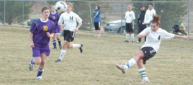 Junior Danielle Price looks to pass to a teammate Thursday against Spring Hill. The Wildcats fell in overtime, 3-2.