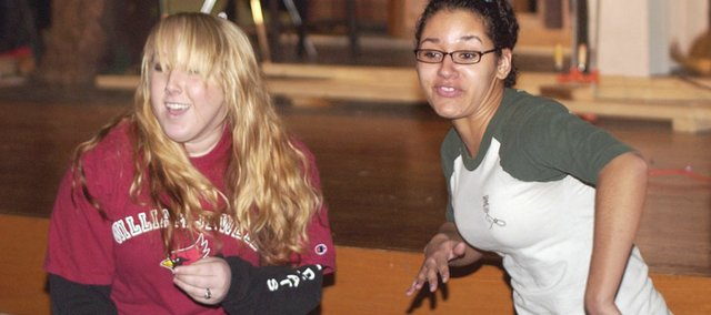 """Jessica Pennington and Jhasmine Roddick rap the essence of Shakespeare's """"Othello"""" during a Tuesday rehearsal of the forensic skit the two De Soto High School seniors will perform in state competition,"""