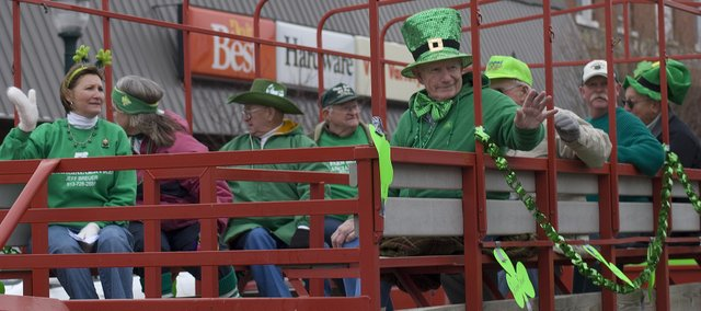 Riding the float of Grand Leprechauns, past and present, are from left, Debbie Breuer, Kay Soetaert, Harold Denholm, Clarence Kelly, Walter Lee Denholm (waving) Bo Himpel, John McCaffrey and Don Pelzl at this year's St. Patrick's Day parade Saturday in downtown Tonganoxie. Pelzl was this year's Grand Leprechaun, while others on the float served as the honorary parade marshals in previous years.