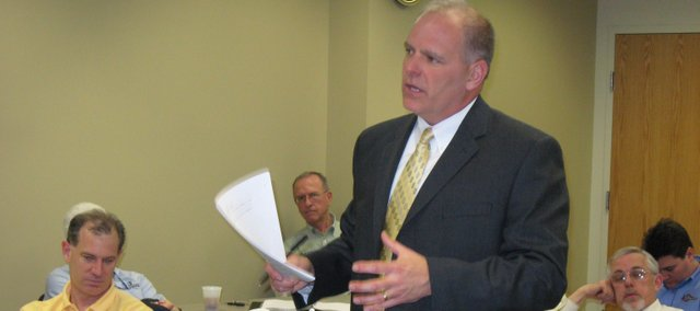 Chris Donnelly, a banker with First State Bank of Tonganoxie and chairman of the Leavenworth County Development Corp.'s infrastructure committee, makes a point to other LCDC members during the group's monthly meeting Thursday at the Leavenworth County Justice Center. Donnelly emphasized a need to refocus the organization's efforts and to unify all municipalities in the county in a concerted effort.