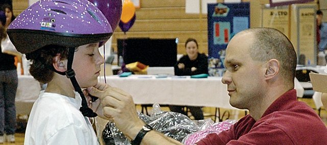 Free bicycle helmets for youngsters will again be available this year at the Community Wellness Festival, which is held at Baker University April 5.