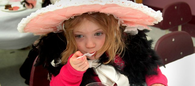 "Erin Ulreich, 3, takes a sip of her ""tea"" during the inaugural Teddy Bear Tea Party at Tonganoxie Public Library. The event was held Wednesday, March 19 at the library. About 10 girls showed up for the event."