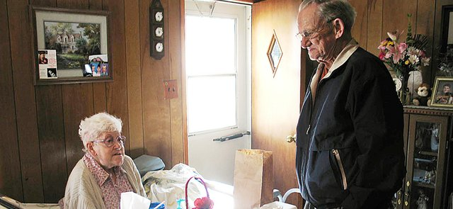 Mayor Kenneth Bernard, right, visits with Dorothy Crawford, of Lansing, after delivering her daily Meals of Wheels. Bernard participated in the Meals of Wheels Association of America's 2008 Mayors For Meals program Wednesday, March 19, along with nearly 1,000 mayors nationwide.