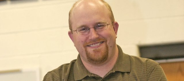 De Soto High band director Justin Love, who rebuilt the school's band after the opening of Mill Valley High School, announced Monday he was taking a job next year with the Olathe school district.