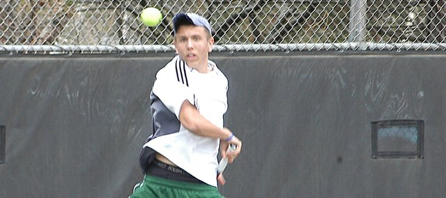 Sophomore Andrew Konetzni returns the ball in his match with teammate Matt Edwards. Konetzni took fourth place at the Washburn Rural Invitational, while Edwards took third.