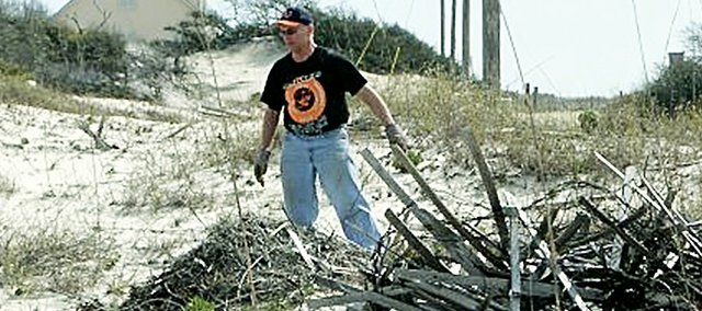 The Rev. Ira DeSpain, Baker University minister, led a group of Baker students to Baldwin County, Ala., over spring break to clean up hurricane debris and do other work at a wildlife refuge.