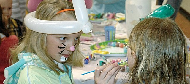 It was face-painting time at Saturday's Rainbow Experience Preschool Easter Egg Hunt. Doing the honors was Corey Valentine, a fifth grader at Baldwin Elementary School Intermediate Center.
