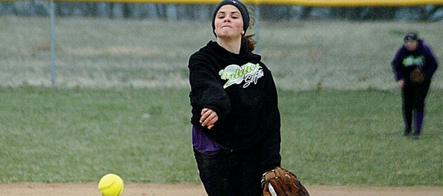 Baldwin High School senior Callie Craig delivers a pitch during the Bulldogs' first game of Thursday's doubleheader against De Soto. Craig pitched both games and helped Baldwin win 16-1 and 7-3 to begin the season 2-0. The Bulldogs play host to Ottawa at 4:30 p.m. today at the BHS ball fields. Check Thursday's Signal full coverage on the BHS softball and baseball teams.