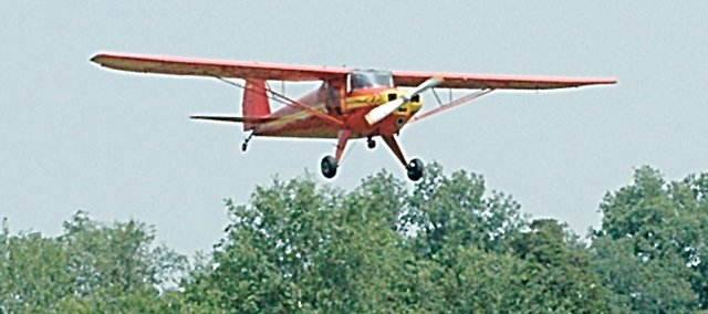 Vinland Airport, north of Baldwin City, will be celebrating the 80th anniversary of a historical Kansas event on Tuesday. Here a plane descends to the runway during the annual Planes, Trains and Automobiles event, which happens in June.