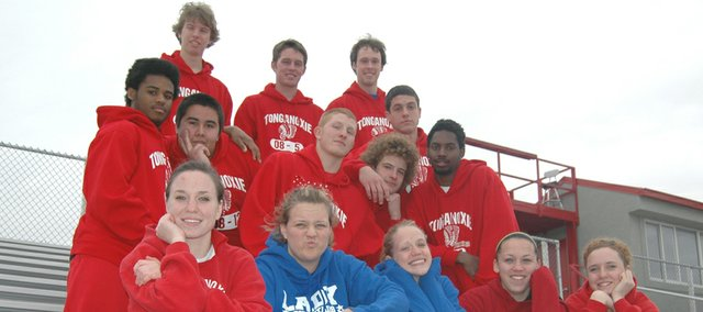 The Tonganoxie High track team keeps things close and loose. This year's seniors are: (front row from left) Katie Chenowith, Elise Drennan, Christy Weller, Roxi Grizzle, Sami Franiuk (middle row) Isiah Sawyer, Chance Rawlins, Wesley Armstrong, D.J. Gray, Kendrick Whittington (back row) Eric Hart, Patrick Holton, Tyler Gurss, Gabe Belobrajdic and (not pictured) Tracie Hileman.