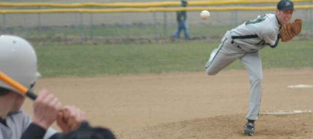 Senior Brady Maasen delivers a pitch against Baldwin March 27. The Wildcats swept the Bulldogs and then were swept by Spring Hill Tuesday.