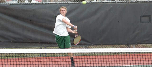 Matt Edwards tries to drop a return shot in March 25 at the Washburn Rural tournament. Edwards went undefeated in Topeka this week, notching three victories.