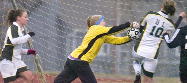 De Soto goalkeeper Jamie Zvirgdins tries to make a save against Basehor-Linwood March 27. The Wildcats won in overtime, 4-3.