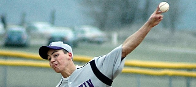Baldwin High School senior Zach Durr releases a pitch during the Bulldogs' first game last Thurday versus De Soto. Durr helped BHS win its first game Tuesday at Ottawa. Baldwin won the second game of the doubleheader 3-2.