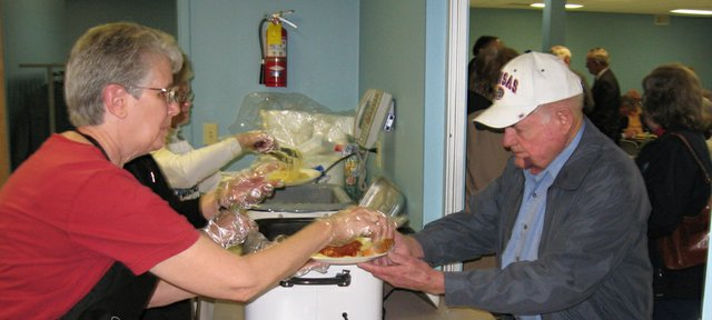 Linda Lockwood, president of the Lansing Historical Society, serves Dusty Rhoads, of Lansing, during the society's 2008 annual spaghetti dinner fundraiser at Lansing Community Center.