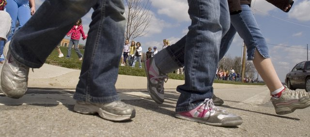 Students at Riverview Elementary School cross a section of 47th Street as they begin their walk for the American Diabetes Association Friday.