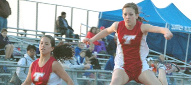 Tonganoxie High's Shelby Maxon and Abby Eisman compete in the 300-meter hurdles on Friday at the Bobcat Relays at Basehor-Linwood High. Eisman finished third in the event with a time of 52.70 and Maxon finished fourth at 54.50.
