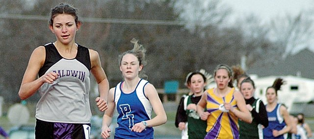 Baldwin High School senior Heather Garcia, left, leads all other runners during the 1,600-meter run at the Baldwin Invitational March 28. Garcia won the race, but she will face some tough competition Friday at the KT Woodman Invitational and next week at the KU Relays.