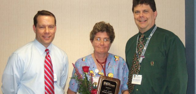 Kathy Jackson, middle, was named the 2007 Employee of Year at Cushing Memorial Hospital.  Pictured to Jackson's left is Ron Baker, Cushing CEO, and to her right is Brett Matthews, Cushing human resources director.