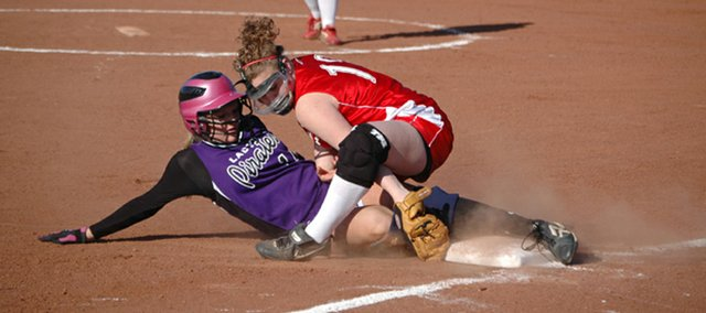 Tonganoxie High third baseman Lindsey Fatherley applies the tag for the final out in the sixth inning of the Chieftains' 7-5 loss to Piper on Monday at Leavenworth County Fairgrounds.