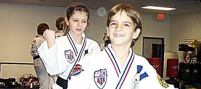 The brother and sister team of Rhett Rinehart, 9, and Aubrey Rinehart, 13, have accomplished something that many adults never do. The Baldwin City youngsters have both gained black belt status in songham Taekwondo.