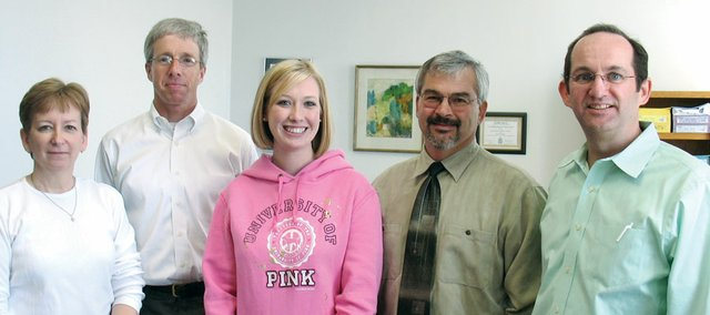 Baker University has named junior Chelsey Forge, center, the winner of the prestigious William G. McGowan Scholarship. Pictured with her, from left, are Martha Harris, Gary Irick, Rand Ziegler and Kevin McCarthy. Harris, Irick and McCarthy are Baker University business professors. Ziegler is the vice president and dean of the College of Arts and Sciences.