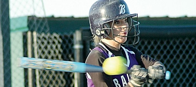 Baldwin High School sophomore MacKenzie Flory makes contact with a pitch while batting during the Bulldogs' second game Tuesday night at Louisburg. Flory helped the Bulldogs sweep the Wildcats, as they won 6-1 and 9-3 to improve their record to 4-2.