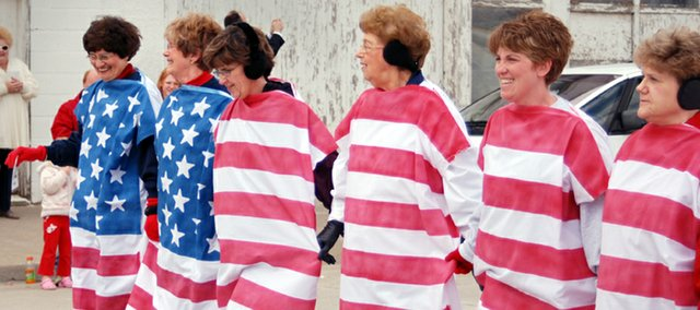 The Walking Flag marched down the street during McLouth's 2007 Patriots' Day Parade. From left are Bank of McLouth co-workers Alicia Wood, Kathy Scott, Sandy Wise, Fern Braksick, Jennifer Pint and Connie Hutchinson. The ladies have been in the parade since 2003.