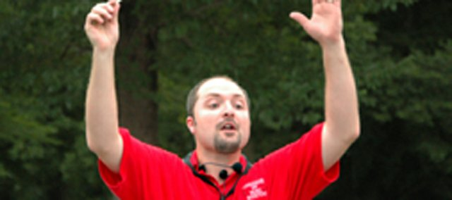 Tonganoxie Community Band director Charles VanMiddlesworth directs a group of roughly 30 musicians at the band's 2007 annual concert  in the VFW Park.