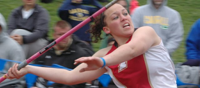 Tonganoxie High senior Roxi Grizzle prepares to launch the javelin on Friday at the Kansas Relays in Lawrence. Grizzle won the event for the second time in her prep career with a throw of 163 feet, 11 inches, a new personal and school record.