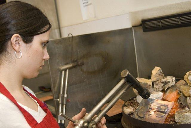 Lisa Smelser uses a blow torch to make her copper derringer lid more malleable. Smelser is a senior at Kansas University.