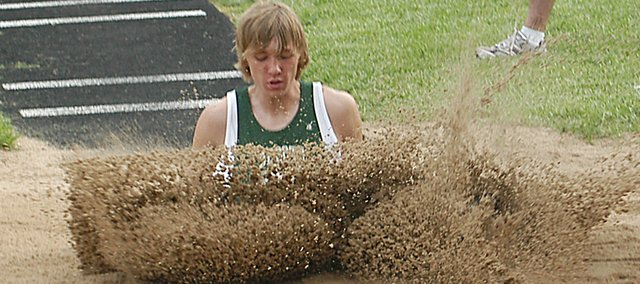 Jordan Riffel lands in the sand pit Monday at the Cardinal Relays. Riffel finished third in the long jump with a leap of 20 feet, 5 and-three-quarter inches.