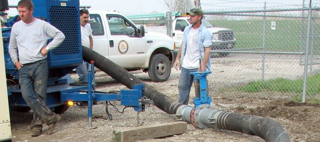 Basehor Public Works crew tests the temporary pump attached to the city's primary sewer force main Monday afternoon. The line broke sometime Sunday night, bypassing sewage into nearby Hog Creek.