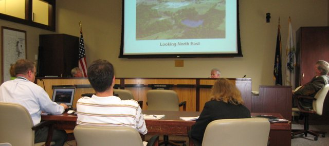Leavenworth County Commissioners and staff review plans for the expansion of a Westar electrical substation just northwest of the intersection of Bauserman Road and 195th Street during a public session on Thursday. Commissioners approved a special use permit for the substation by a 3-0 vote.