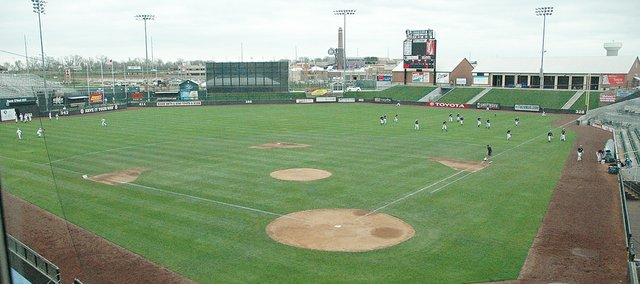 The Bonner Springs and  Holton baseball teams warm up prior to their game Thursday at CommunityAmerica Ballpark.