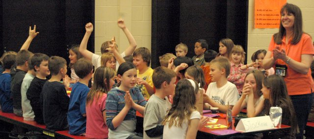 "Tonganoxie Elementary School teacher Karen Stockman and her third-grade class react to the news Thursday, April 17 in the TES south gymnasium that their book, ""K is for Kansas,"" was selected as one of 25 winners in a national publishing contest."