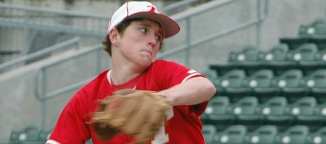 Tonganoxie HIgh starting pitcher Jace Waters begins to fire a pitch on Friday against Paola at Community America Ballpark. Waters pitched five innings, struck out three and walked one in an 11-1 Chieftains victory.