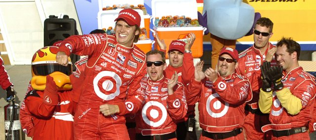 Dan Wheldon, standing on his car, celebrates after winning the Road Runner Turbo Indy 300. Wheldon repeated as Kansas Speedway IndyCar champ Sunday.