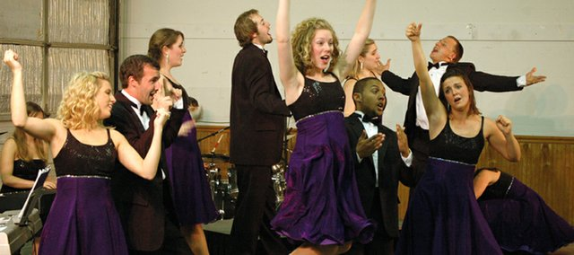 K-State Singers members are animated during one of their numbers Saturday at the Leavenworth County Fairgrounds. The group performed for the 4-H annual meeting.