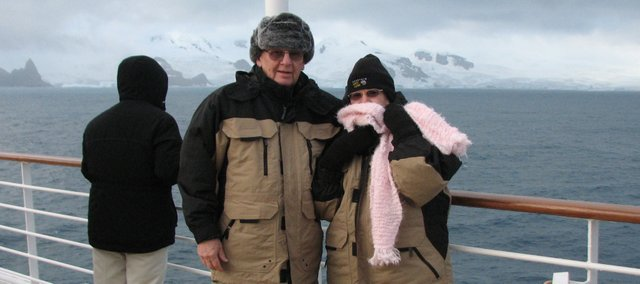 Fred Bohm and Sharon Burns-Bohm stand bundled up on the deck of a cruise ship off the coast of Antarctica. The Eudora couple took a 19-day vacation to Antarctica in February and said it was a once-in-a-lifetime experience.